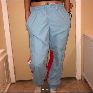 REEBOK BLUE RED AND WHITE WINDBREAKER PANTS
